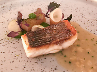 Third course of Altantic sea bass, turnip cabbage, salty lemon sauce at Ecco St Moritz. Photo Sydney Low