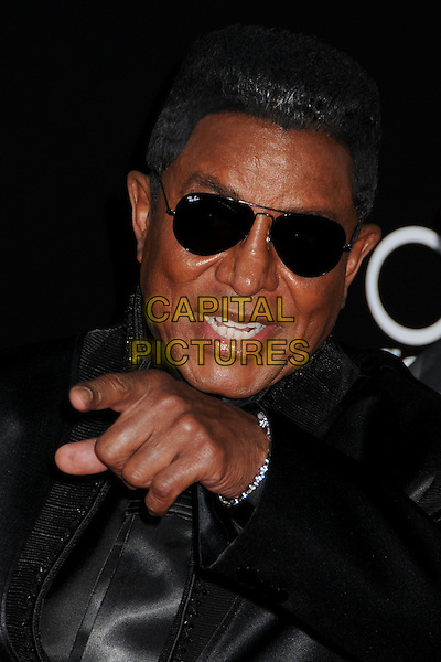 JERMAINE JACKSON. 2009 American Music Awards - Arrivals held at the Nokia Theatre L.A. Live, Los Angeles, California, USA..November 22nd, 2009.AMA AMA's headshot portrait black sunglasses shades hand pointing finger.CAP/ADM/BP.©Byron Purvis/AdMedia/Capital Pictures.