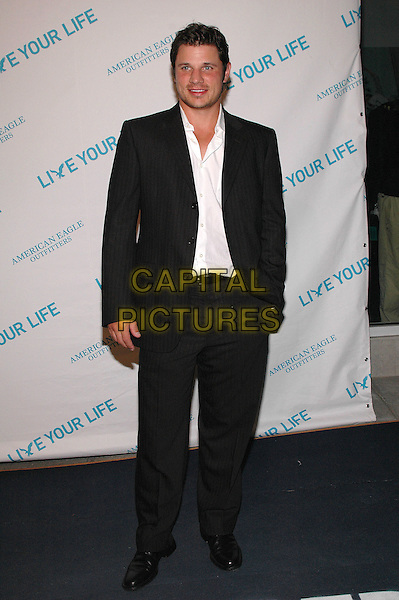 "NICK LACHEY.American Eagle Outfitters' ""Live Your Life Contest"" winners at the Union Square flagship store in Manhattan, New York, New York..July 27th, 2005  .Photo Credit: Patti Ouderkirk/AdMedia.full length black suit.www.capitalpictures.com.sales@capitalpictures.com.© Capital Pictures."
