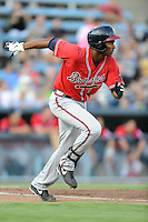 Rome Braves third baseman Carlos Franco #11 runs to first during a game against the Asheville Tourists at McCormick Field on July 25, 2013 in Asheville, North Carolina. The Tourists won the game 9-6. (Tony Farlow/Four Seam Images)
