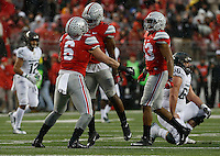 Ohio State Buckeyes linebacker Raekwon McMillan (5) congratulates Ohio State Buckeyes defensive end Sam Hubbard (6) on his sack in the first half of their game at Ohio Stadium in Columbus, Ohioan November 21, 2015. (Columbus Dispatch photo by Brooke LaValley)