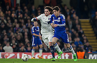 Oscar of Chelsea & Adrien Rabiot of Paris Saint-Germain in action during the UEFA Champions League Round of 16 2nd leg match between Chelsea and PSG at Stamford Bridge, London, England on 9 March 2016. Photo by Andy Rowland.