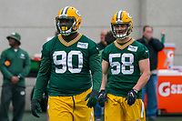 Green Bay Packers defensive tackle Montravius Adams (90) and linebacker Jordan Tripp (58) during an Organized Team Activity on May 23, 2017 at Clarke Hinkle Field in Green Bay, Wisconsin.  (Brad Krause/Krause Sports Photography)