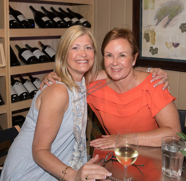 Emily Durr and Estrella Bailey during Reno Magazine's Fall Fashion Styling at the Whispering Vine Wine Co. on Saturday, August 19, 2017.