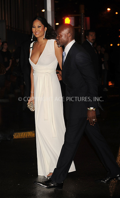 "WWW.ACEPIXS.COM . . . . .  ....February 6 2008, New York City....Actor Djimon Honsou and Kimora Lee Simmons arriving at ""A Night to Benefit Raising Malawi and UNICEF"" hosted by Madonna and Gucci at theUnited Nations in midtown Manhattan.....Please byline: KRISTIN CALLAHAN - ACEPIXS.COM..... *** ***..Ace Pictures, Inc:  ..te: (646) 769 0430..e-mail: info@acepixs.com..web: http://www.acepixs.com"