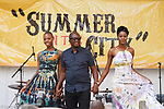 Fashion designer Raiff walks stage with models at the close of his Raiff L'Atelier fashion show during Harlem Week 2017 at 135th Street and St. Nicholas Avenue in New York City on August 19, 2017.