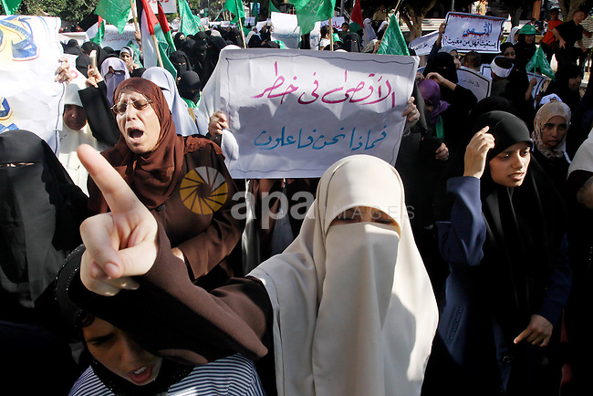 Hamas women supporters shout slogans against Israel during a demonstration in Gaza city on Sep 28,2009 against the entry of Israeli policement into the Al-Aqsa mosques compound, Islam's third holiest shrine, in Jerusalem's Old City. Clashes were erupted in Jerusalem's Old City after a scuffle broke out at the Al-Aqsa, a flashpoint site revered by both Muslims and Jews, police and witnesses said. Photo by Mohammed Asad
