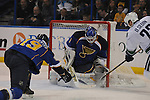 Vancouver Canucks left wing Daniel Sedin (22) shoots from point-blank range on St. Louis Blues goalie Brian Elliott (1) as St. Louis Blues defenseman Jay Bouwmeester (19, left) tries to block the puck in second period action during a game between the Vancouver Canucks and the St. Louis Blues on Tuesday April 16, 2013 at the Scottrade Center in downtown St. Louis.