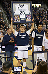 Nevada's David Cunningham (20) holds up his framed jersey during senior night before an NCAA college basketball game against San Diego State in Reno, Nev., Saturday, March 9, 2019. (AP Photo/Tom R. Smedes)