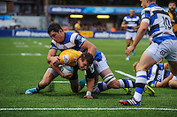 Lee Dickson is tackled by Francois Louw. Amlin Challenge Cup Final, between Bath Rugby and Northampton Saints on May 23, 2014 at the Cardiff Arms Park in Cardiff, Wales. Photo by: Rogan Thomson / Onside Images