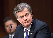Federal Bureau of Investigation (FBI) Director Christopher Wray testifies before the United States Senate Committee on Intelligence during a hearing to examine worldwide threats on Capitol Hill in Washington, DC on Tuesday, February 13, 2018<br /> Credit: Ron Sachs / CNP
