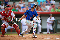 St. Lucie Mets shortstop J.C. Rodriguez (2) follows through on a swing in front of Florida Fire Frogs catcher Tanner Murphy (39) during a game against the Florida Fire Frogs on July 23, 2017 at Osceola County Stadium in Kissimmee, Florida.  St. Lucie defeated Florida 3-2.  (Mike Janes/Four Seam Images)