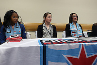 INDIANAPOLIS, IN - January 18, 2013: Chicago Red Stars technical staff with #1 pick Zakiya Bywaters (left). The National Women's Soccer League held its college draft at the Indiana Convention Center in Indianapolis, Indiana during the NSCAA Annual Convention.