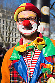 Düsseldorf, Germany. 15 February 2015. Clown celebrating carnival. Street carnival celebrations take place on Königsallee (Kö) in Düsseldorf ahead of the traditional Shrove Monday parade (Rosenmontagszug).