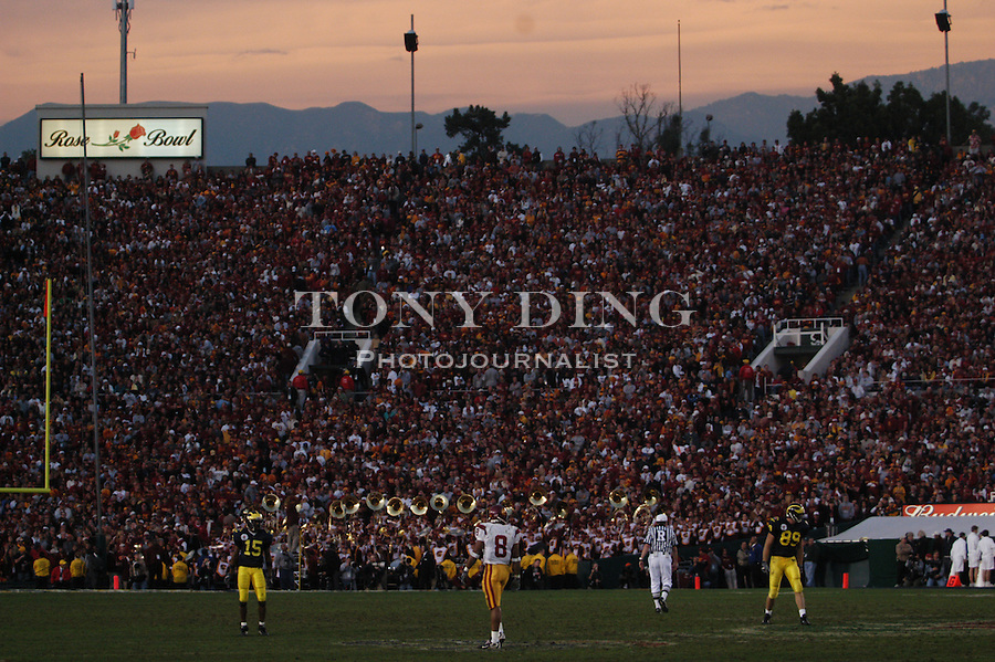 Highlighted in sunset, the San Gabriel Mountains peak out from the top of the stadium during the Wolverines' 14-28 loss to USC on Thursday, January 1, 2004 at the Rose Bowl in Pasadena, California. It was Michigan's 18th appearance at the Rose Bowl and the 90th game the bowl has played. (TONY DING/The Michigan Daily)
