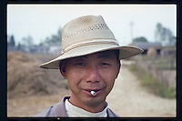 A Chinese peasant enjoys puffing a cigarette at a village in Jiangsu province, China, 1998.