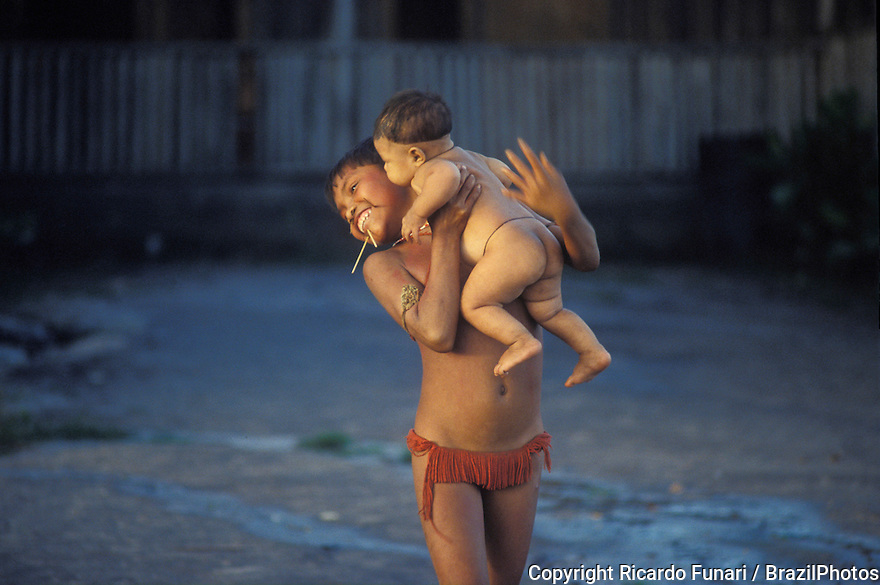 Amazon rain forest, Brazil. Yanomami indigenous people. Girl and baby, tenderness and happiness.