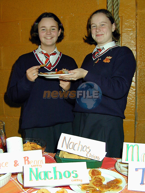 Amy Murphy, Mornington and Caroline Murphy from Meadowview sampling Spanish foods at the Spanish Day in the Sacred Heart School..Picture Paul Mohan Newsfile