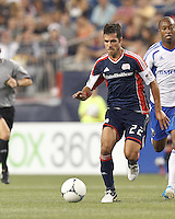 New England Revolution midfielder Benny Feilhaber (22) dribbles. In a Major League Soccer (MLS) match, Montreal Impact defeated the New England Revolution, 1-0, at Gillette Stadium on August 12, 2012.