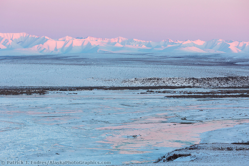 Pink light falls on the Philip Smith Mountains and Sag River in the Brooks Range, Arctic, Alaska.