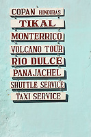 Local service signs in Antigua, a UNESCO World Heritage Site in Guatemala