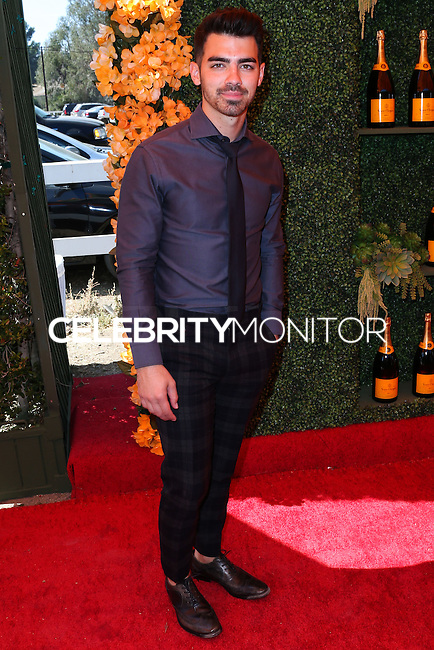 PACIFIC PALISADES, CA, USA - OCTOBER 11: Joe Jonas arrives at the 5th Annual Veuve Clicquot Polo Classic held at Will Rogers State Historic Park on October 11, 2014 in Pacific Palisades, California, United States. (Photo by Xavier Collin/Celebrity Monitor)