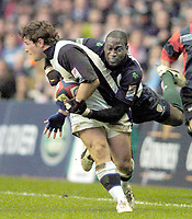 2004/05 Zurich Premiership,London Irish vs Sale Sharks, Madejski Stadium, Reading, ENGLAND: Exile Paul Sackey, with a flying tackle on Sharks Andy Titterell..Photo  Peter Spurrier. .email images@intersport-images...