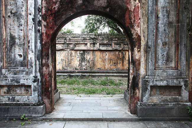 A gate is still pockmarked with bullet holes from the Vietnam War inside the Citadel in the former imperial capital of Hue, Vietnam. April 21, 2013.