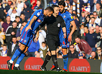 Bolton Wanderers' Gary O'Neil demonstrates to referee Tony Harrington that he disagreed with the penalty decision<br /> <br /> Photographer Alex Dodd/CameraSport<br /> <br /> The EFL Sky Bet Championship - Leeds United v Bolton Wanderers - Saturday 23rd February 2019 - Elland Road - Leeds<br /> <br /> World Copyright © 2019 CameraSport. All rights reserved. 43 Linden Ave. Countesthorpe. Leicester. England. LE8 5PG - Tel: +44 (0) 116 277 4147 - admin@camerasport.com - www.camerasport.com