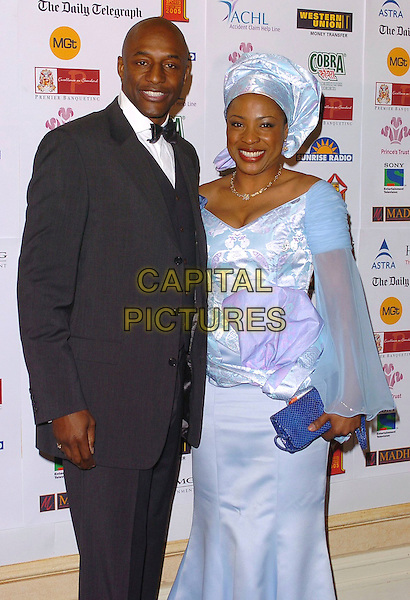 JOHN FASHANU & GUEST.Sony Entertainment Television Asian Sports Personality Of The Year Awards, HIlton Park Lane Hotel, .London, England, February 4th 2006..half length blue dress turban hair scarf.Ref: CAN.www.capitalpictures.com.sales@capitalpictures.com.©Capital Pictures