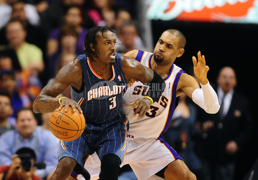 Jan. 26, 2011; Phoenix, AZ, USA; Charlotte Bobcats forward (3) Gerald Wallace against Phoenix Suns forward (33) Grant Hill at the US Airways Center. The Bobcats defeated the Suns 114-107. Mandatory Credit: Mark J. Rebilas-