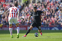 Liverpool's Emre Can under pressure from Stoke City's Geoff Cameron<br /> <br /> Photographer Terry Donnelly/CameraSport<br /> <br /> The Premier League - Stoke City v Liverpool - Saturday 8th April 2017 - bet365 Stadium - Stoke-on-Trent<br /> <br /> World Copyright &copy; 2017 CameraSport. All rights reserved. 43 Linden Ave. Countesthorpe. Leicester. England. LE8 5PG - Tel: +44 (0) 116 277 4147 - admin@camerasport.com - www.camerasport.com