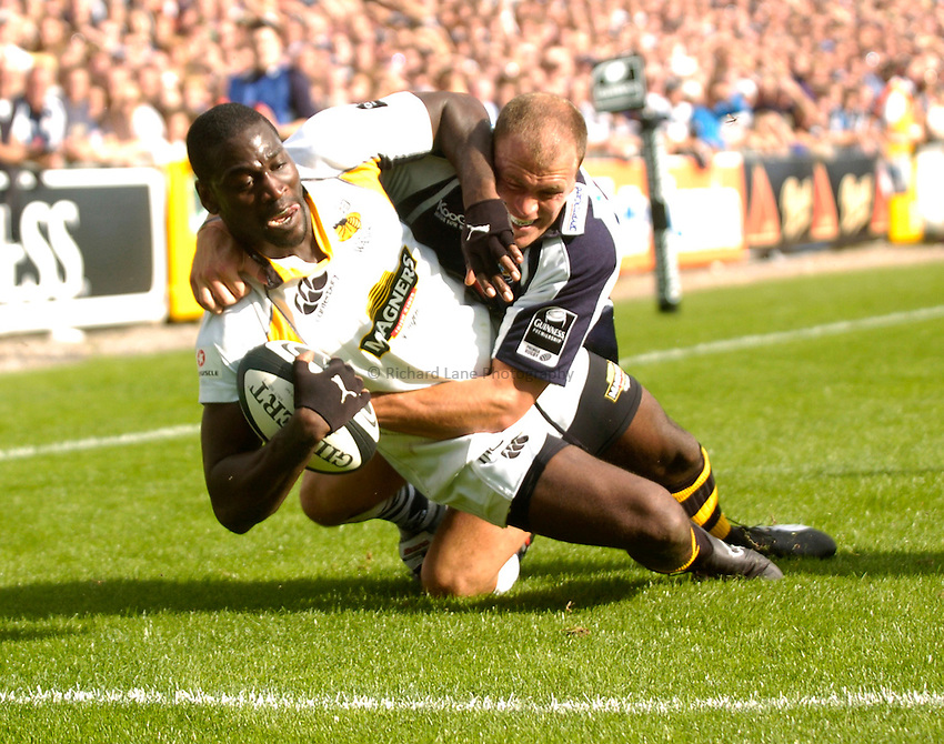 Photo: Richard Lane..Bristol Rugby v London Wasps. Guinness Premiership. 24/09/2006. .Wasps' Paul Sackey goes over to score a try as Craig Morgan tackles.