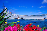 The battleship U.S.S Missouri is towed into Pearl Harbor on it's final journey to  become a floating museum to WWII naval history.