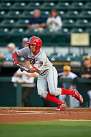Clearwater Threshers shortstop Emmanuel Marrero (33) squares around to bunt during a game against the Bradenton Marauders on April 18, 2017 at LECOM Park in Bradenton, Florida.  Clearwater defeated Bradenton 4-2.  (Mike Janes/Four Seam Images)