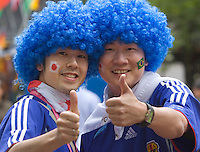 Germany, DEU, Dortmund, 2006-Jun-22: FIFA football world cup (USA: soccer world cup) 2006 in Germany; two Japanese football fans in good mood posing with blue wigs before the world cup match Japan vs. Brazil (1:4).