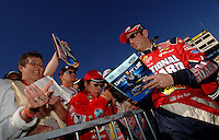 Nov 12, 2005; Phoenix, Ariz, USA;  Nascar Nextel Cup driver Greg Biffle signs autographs after qualifying for the Checker Auto Parts 500 at Phoenix International Raceway. Mandatory Credit: Photo By Mark J. Rebilas