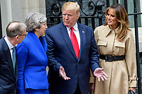 LONDON, ENGLAND - JUNE 04: Prime Minister Theresa May and husband Philip May welcome US President Donald Trump and First Lady Melania Trump to 10 Downing Street, during the second day of his State Visit on June 4, 2019 in London, England. <br /> CAP/CAM<br /> ©Andre Camara/Capital Pictures