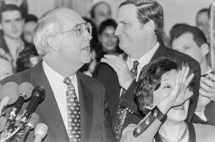 Sen. Phil Gramm, R-Tex. with his wife Wendy Lee Gramm and Sen. Bob Smith, R-N.H. on Feb. 15, 1996. (Photo By Laura Patterson/CQ Roll Call)