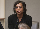 Denise Johnson, wife of sniper victim Conrad Johnson, listens during her testimony in the trial of sniper suspect John Allen Muhammad in courtroom 10 at the Virginia Beach Circuit Court in Virginia Beach, Virginia on November 3, 2003. Johnson described hearing news reports about a bus driver being shot but did not find out until later that it was her husband. <br /> Credit: Lawrence Jackson - Pool via CNP