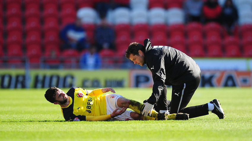 Fleetwood Town's Conor McLaughlin receives treatment from Fleetwood Town's Physiotherapist Luke Bussey for a injury<br /> <br /> Photographer Chris Vaughan/CameraSport<br /> <br /> Football - The Football League Sky Bet League One - Doncaster Rovers v Fleetwood Town - Saturday 18th April 2015 - Keepmoat Stadium - Doncaster<br /> <br /> &copy; CameraSport - 43 Linden Ave. Countesthorpe. Leicester. England. LE8 5PG - Tel: +44 (0) 116 277 4147 - admin@camerasport.com - www.camerasport.com