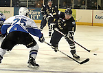 SIOUX FALLS, SD - APRIL 16:  Ian Mansfield #8 from the Sioux Falls Stampede flips the puck past Justin Woods #25 from the Lincoln Stars in the first period of their 2013 USHL playoff game Tuesday night at the Sioux Falls Arena. (Photo by Dave Eggen/Inertia)