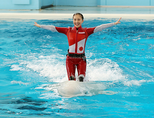 "April 26, 2017, Yokohama, Japan - Kanako Momota, a member of Japanese girls only pop group ""Momoiro Clover Z"" (MCZ) rides on the back of a white beluga at the aquarium of the Hakkeijima Sea Paradise in Yokohama, suburban Tokyo on Wednesday, April 26, 2017. The aquarium will start the new attraction with sea aninals featuring a MCZ's TV program for children from April 28.   (Photo by Yoshio Tsunoda/AFLO) LwX -ytd-"