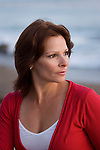 Mature woman at beach, portrait profile