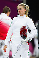 12 AUG 2012 - LONDON, GBR - Natalya Coyle (IRL) of Ireland waits for her next match during the women's London 2012 Olympic Games Modern Pentathlon fencing at The Copper Box in the Olympic Park, in Stratford, London, Great Britain (PHOTO (C) 2012 NIGEL FARROW)