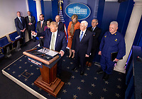 United States President Donald J. Trump delivers remarks about the Coronavirus COVID-19 pandemic alongside US Vice President Mike Pence and members of the Coronavirus Task Force in the Brady Press Briefing Room at the White House in Washington, DC, March 17, 2020, in Washington, D.C. <br /> Credit: Kevin Dietsch / Pool via CNP/AdMedia