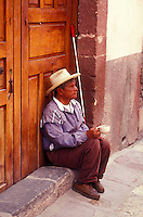 Blind beggar sitting in a doorway, San Miguel de Allende, Mexico