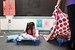 September 14, 2011. Raleigh, NC. . After lunch, all children lay down for a 1.5 hour nap.. Project Enlightenment, a public pre-kindergarten program for at risk children, has been threatened with closure due to state wide budget cuts..