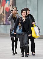 Women shopping on Nanjing Road, central Shanghai, China