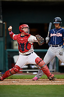 Harrisburg Senators catcher Jake Lowery (3) throws to second base in front of Max Pentecost (7) during the second game of a doubleheader against the New Hampshire Fisher Cats on May 13, 2018 at FNB Field in Harrisburg, Pennsylvania.  Harrisburg defeated New Hampshire 2-1.  (Mike Janes/Four Seam Images)